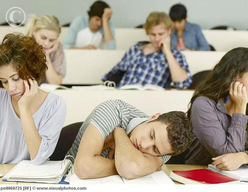 bored_college_students_sleeping_in_lecture_hall_pe0068725.jpg